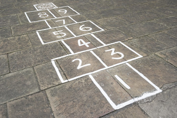 Hopscotch children's game outside on pavement
