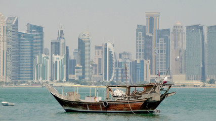 a dhow moored in the port of doha, in qatar