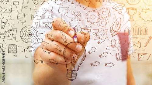 businessman drawing manuscript project presentation with a pen