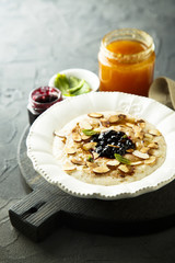 Oatmeal porridge with jam, honey and nuts