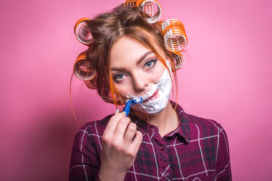 Woman in curlers shaves