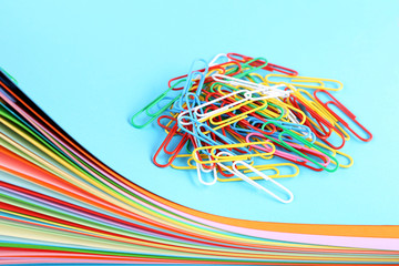 Stack of colored papers with paperclips