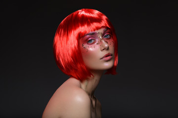 Beautiful girl in red wig