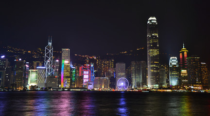 Night view of skyscrapers Hong Kong island from Kowloon public pier. Hong Kong, March 2016 by Victoriia Avhustinovych