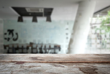 Selected focus empty old wooden table and meeting room or office work blur background image. for your photomontage or product display