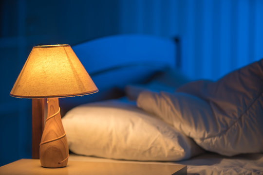 The lamp against the background of the bed. night time