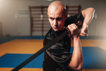 Foto op Aluminium Vechtsport Wushu master with blade in action, martial arts