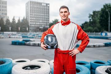 Poster Motorise Kart driver with helmet in hands, Go-kart