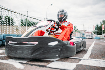 Poster Motorise Kart racer on start line, go cart driver