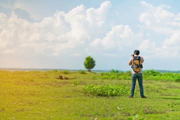 young tourist man photograph lanscape