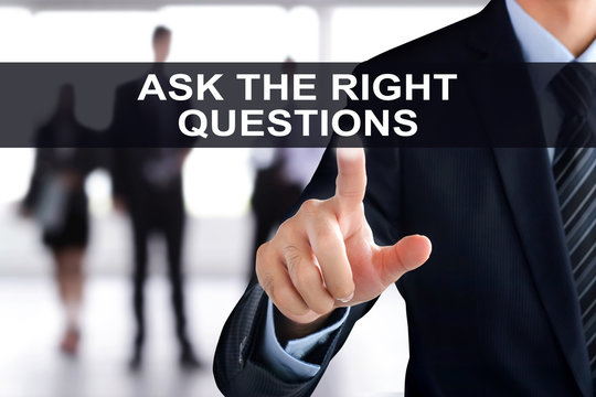 Businessman hand touching ASK THE RIGHT QUESTIONS tab on virtual screen