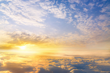sunset clouds sky skyscape. view from the window of an airplane flying in the clouds, top view clouds like  the sea of clouds sky background