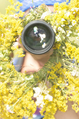 Photographer on a flower meadow