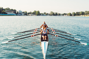 four athlete canoe rowing