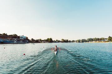 four athlete canoe rowing