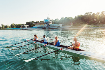 Rowers in racing shell