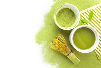 Green matcha tea in a bowl and bamboo whiskon isolated on white,top view
