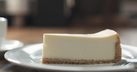 cheesecake with espresso on table