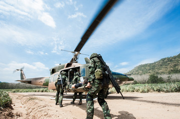 Thai Army Soldiers with full uniform preparing to carry patient to the aircraft, military training
