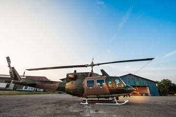 The image blurred of Army Helicopter parking at the hangar in the morning with sunrise.