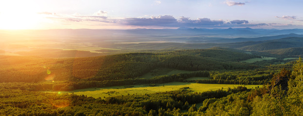 Poster Hill Aerial panorama view of greenery hills and meadow at sunrise in Ural, Russia