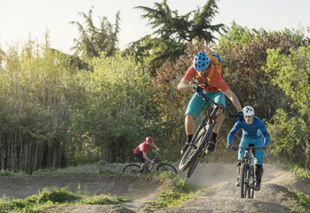 Mountain bikers biking through dirt course