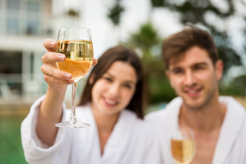 Young couple tasting wine