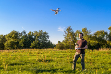 Man operating a drone quad copter