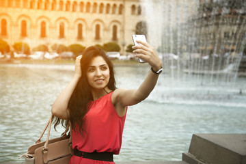 woman taking selfie at street