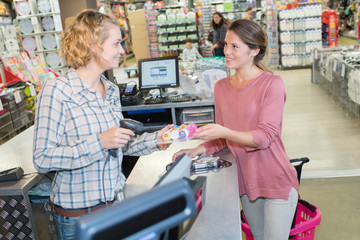 shop assistant scanning product