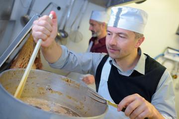 chef stiring at industrial kitchen