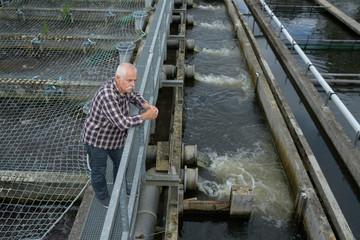 ficherman looking at water dam
