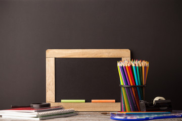 back to school, school supplies on wooden background