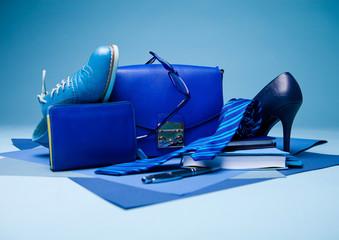 Blue color fashion style still life setup on blue