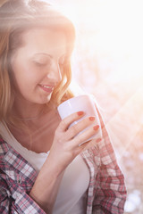 Coffee. Beautiful Girl Drinking morning Coffee. Beauty Model Woman with the Cup of Beverage.