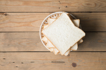 slice of bread on wood table,top view,food concept