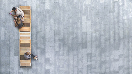 top aerial view of people sit on wood bench at the upper floor pedestrian.