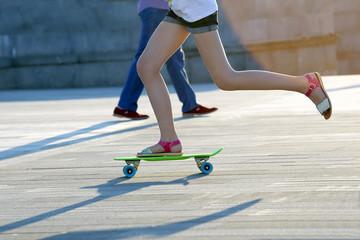 feet girls skateboarding in the city.