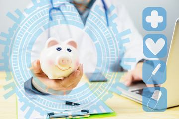 Doctor holding out your piggy bank wanting payment/ Your Savings To Pay Bill, insert coins to it,Stethoscope financial checkup or saving for medical insurance costs money plan fee Lifestyle concept