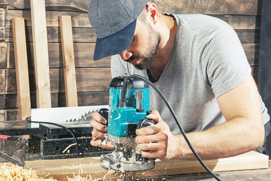 man equals  wooden with a milling machine