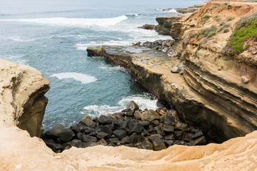 Sunset Cliffs in San Diego with waves crashing on rocks