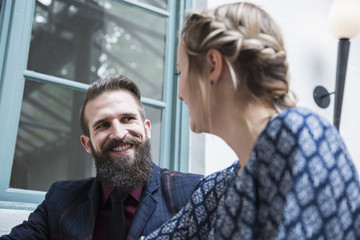 Young couple smiling while looking at each other