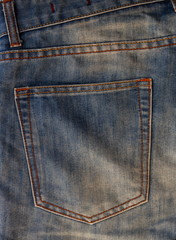 Empty back pocket of jeans, background texture