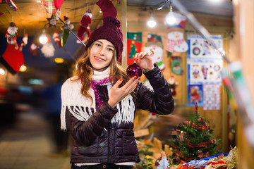 Portrait of young smiling woman at Christmas fair