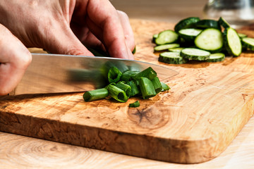 slicing vegetables with a knife for cooking