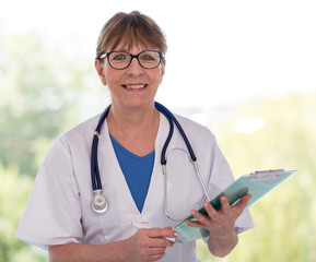 Portrait of female doctor holding a clipboard