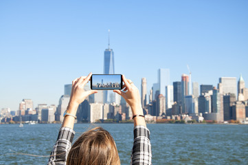 Young woman photographing New York City skyline