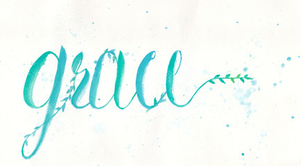 Grace calligraphy design by water color hand lettering in blue green color on white color of paper.