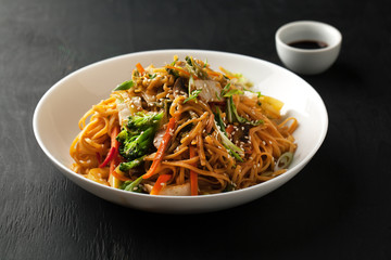 Udon noodles with fresh vegetables with soy sauce