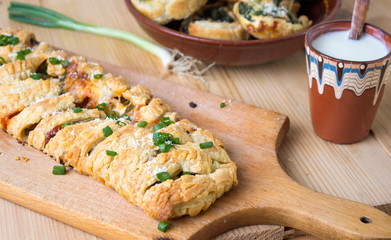 Puff pastry with pizza ingredients and onions